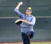 Feb 16, 2019; Phoenix, AZ, USA; Milwaukee Brewers right fielder Christian Yelich (22) throws during a spring training workout at the Maryvale Baseball Park practice fields. Mandatory Credit: Joe Camporeale-USA TODAY Sports