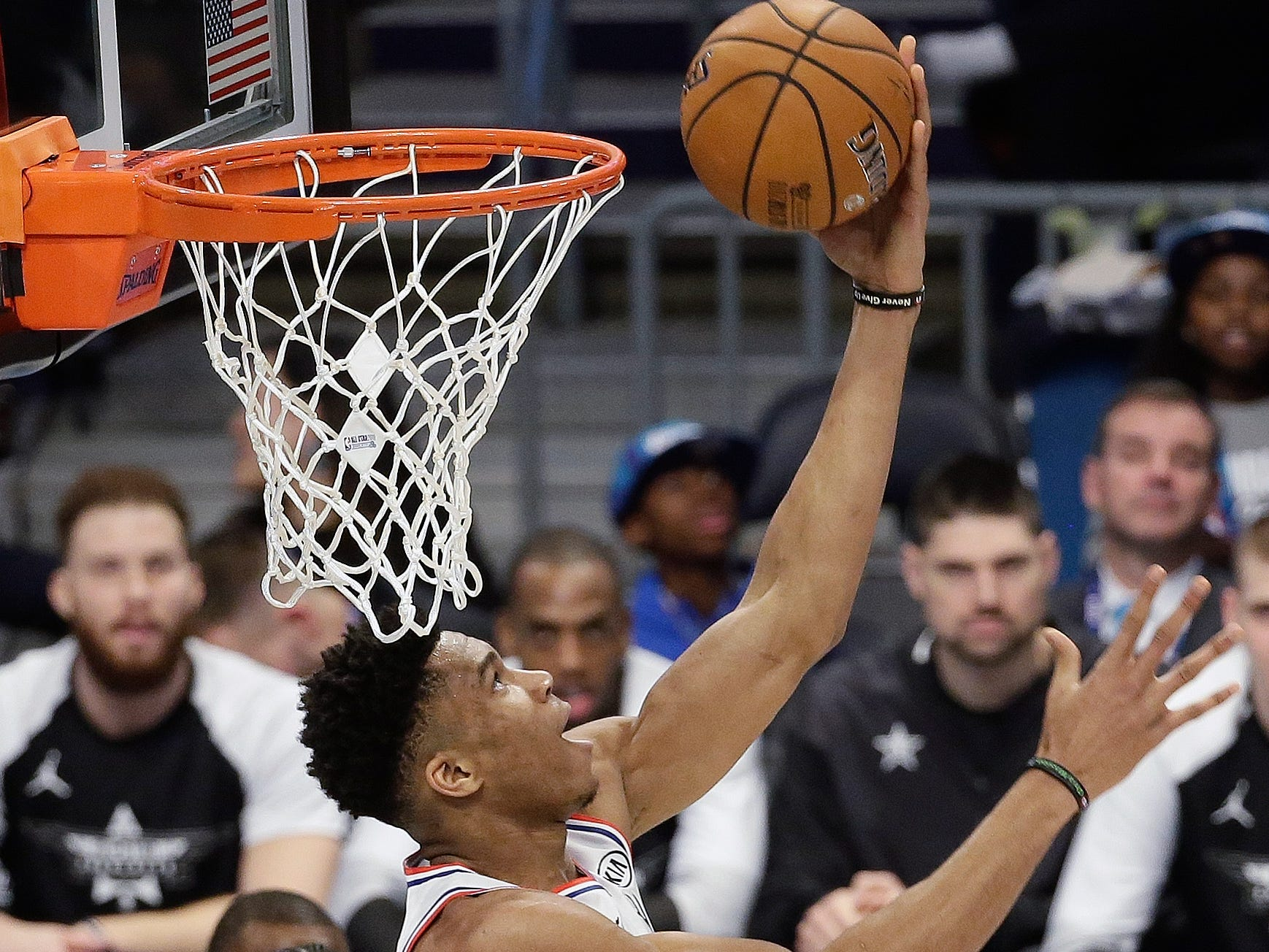 Giannis Antetokounmpo rises above the rim during the NBA All-Star Game.
