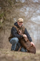 Jeff Fuller poses with Pickett, a Labrador Retriever owned by his kennel, Soggy Acres Retrievers in Delavan.