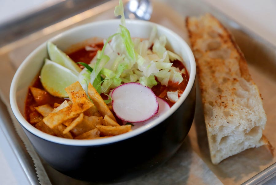 Frida soup and sandwiches offers this Pork Pozole soup at Crossroads Collective food hall at 2238 N. Farwell Ave., in Milwaukee on Monday, Feb. 11, 2019.