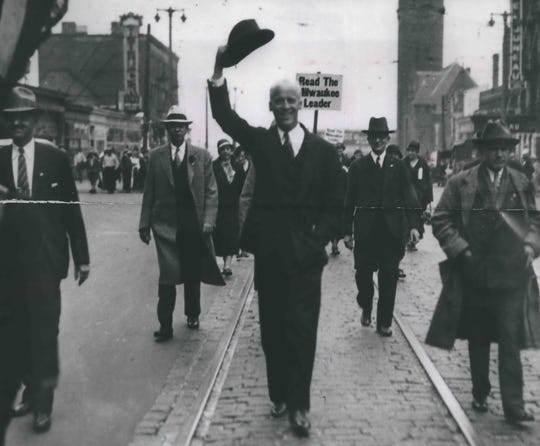 Socialist Party presidential candidate Norman Thomas greets well wishers as he walks down East Wisconsin Avenue during the 1932 campaign.