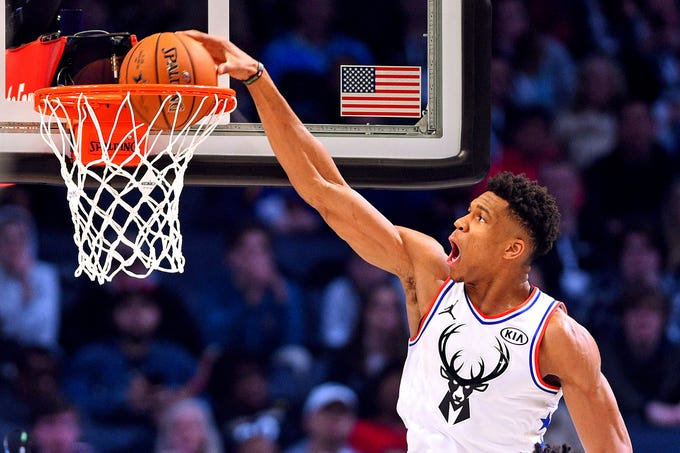 Bucks forward Giannis Antetokounmpo finishes one of his dunks  in the NBA All-Star Game.