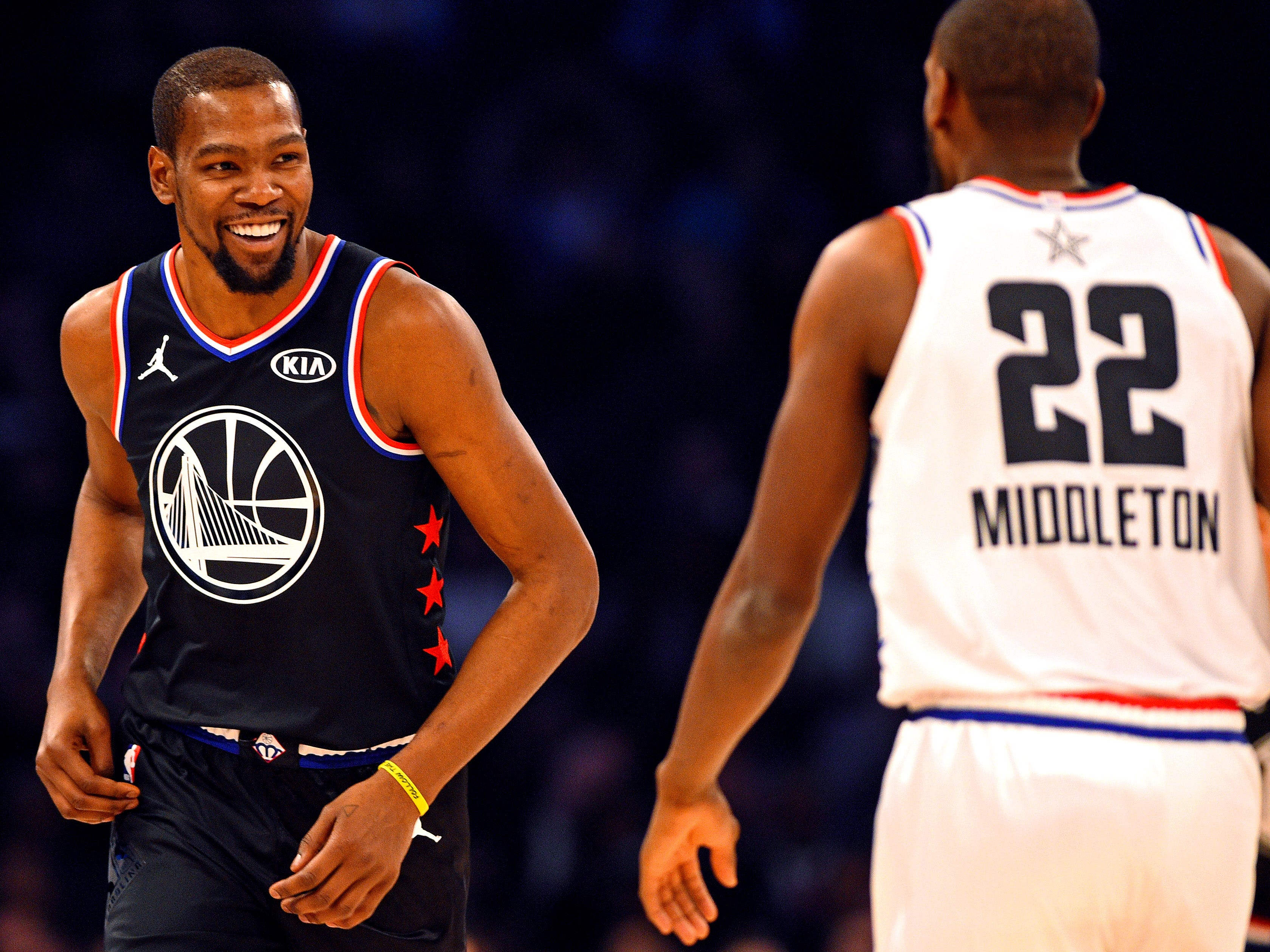 Kevin Durant of the Golden State Warrior shares a laugh with Khris Middleton.