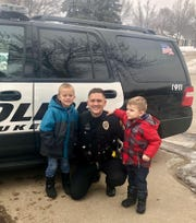 Waukesha Police Officer Nick Sharon poses with Jordi Olson (left) and his younger brother Emmit. Jordi requested that the Waukesha Police Department come to his birthday party on Feb. 16.