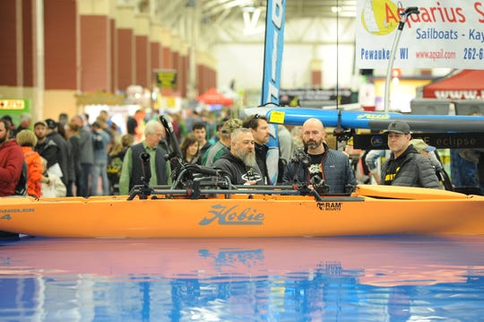 Milwaukee Journal Sentinel Sports Show atendees check out a kayak in the indoor pool used for demonstrations during the 2-18 show.