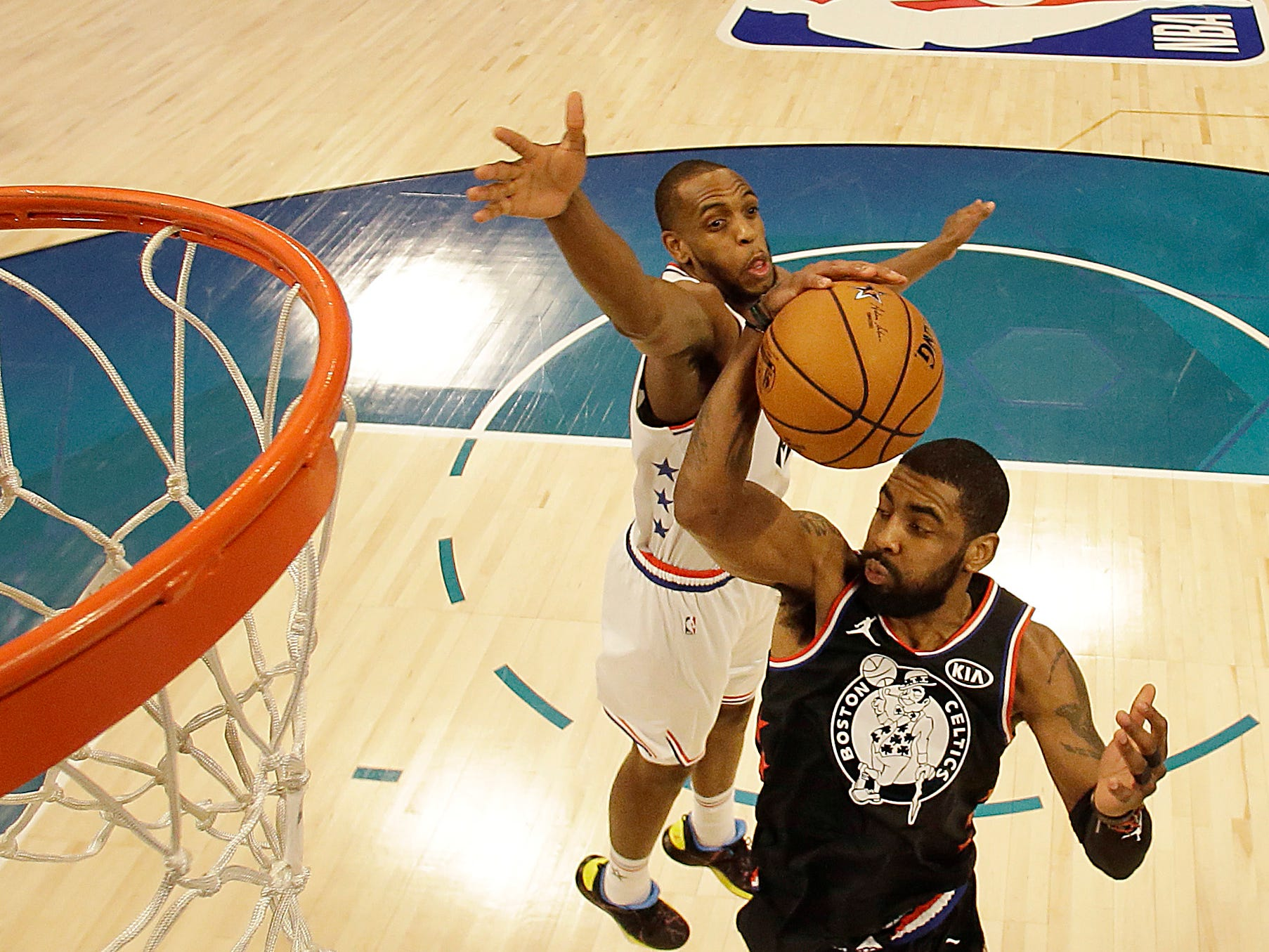 Bucks guard Khris Middleton, who scored 20 points, tries to block a layup by Kyrie Irving in the NBA All-Star Game.