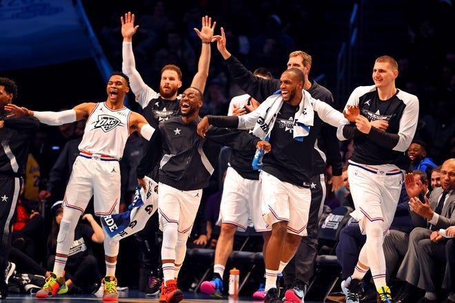 Khris Middleton and Team Giannis celebrate one of Giannis Antetokounmpo's many dunks on Sunday night.
