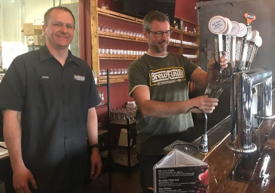 Brewfinity Brewing Co. owners Chad Ostram (left) and Eric Zunke were once just home brewers who made beer as a hobby. Now, they own their own brewery.