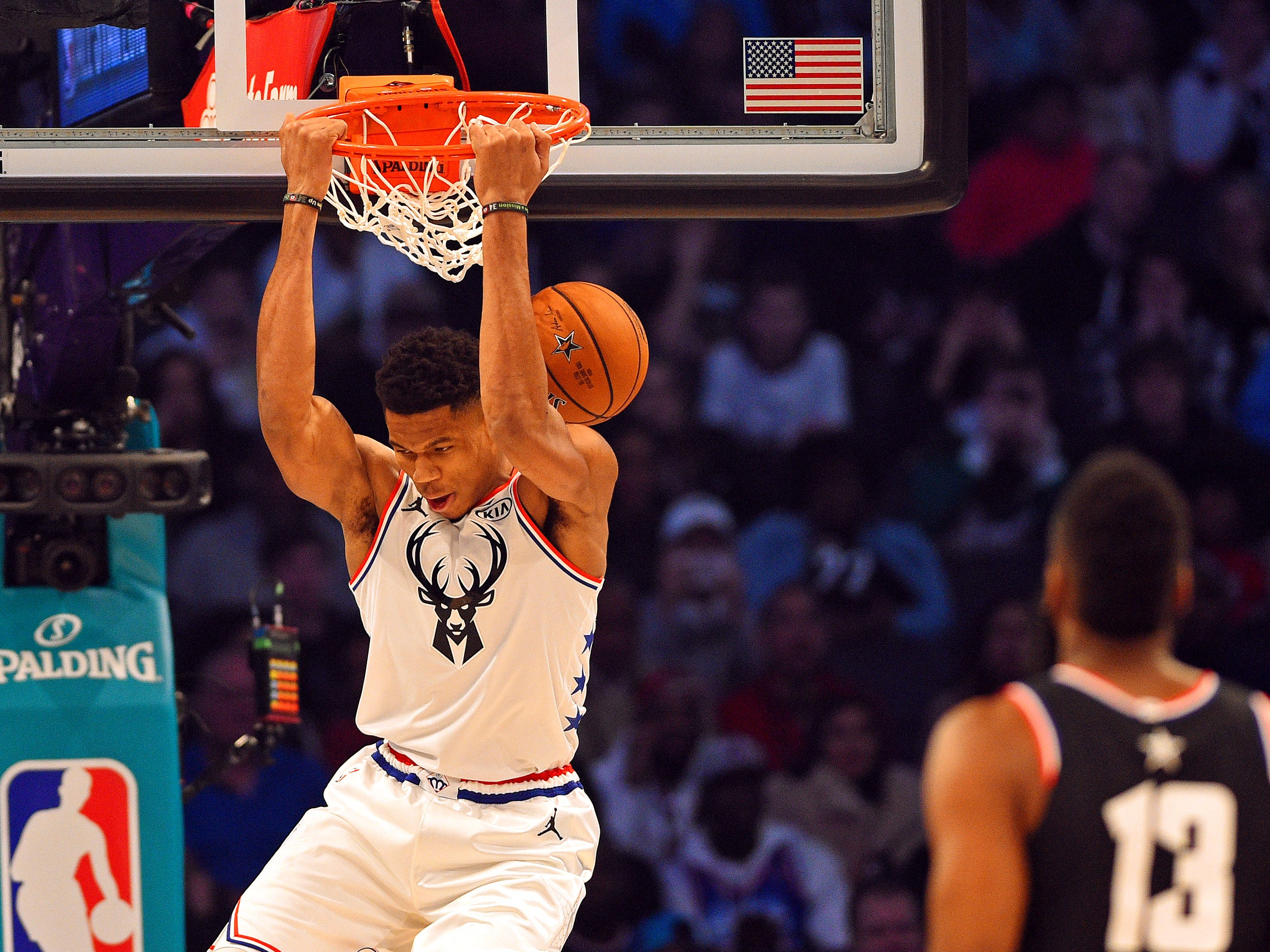 Giannis Antetokounmpo slams two of his 20 first-half points during the NBA All-Star Game.