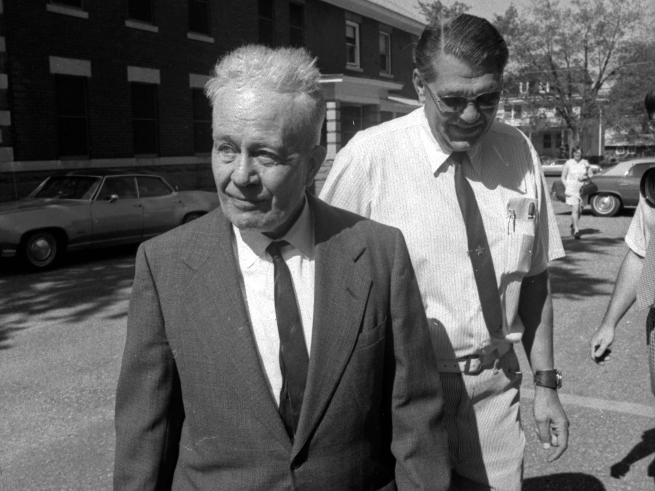 "Ed Gein was escorted by Waushara County Sheriff Virgil Batterman (right) as he arrived for a sanity hearing in Wautoma in 1974."" He was in court to try to be released after 17 years at Central State mental hospital."