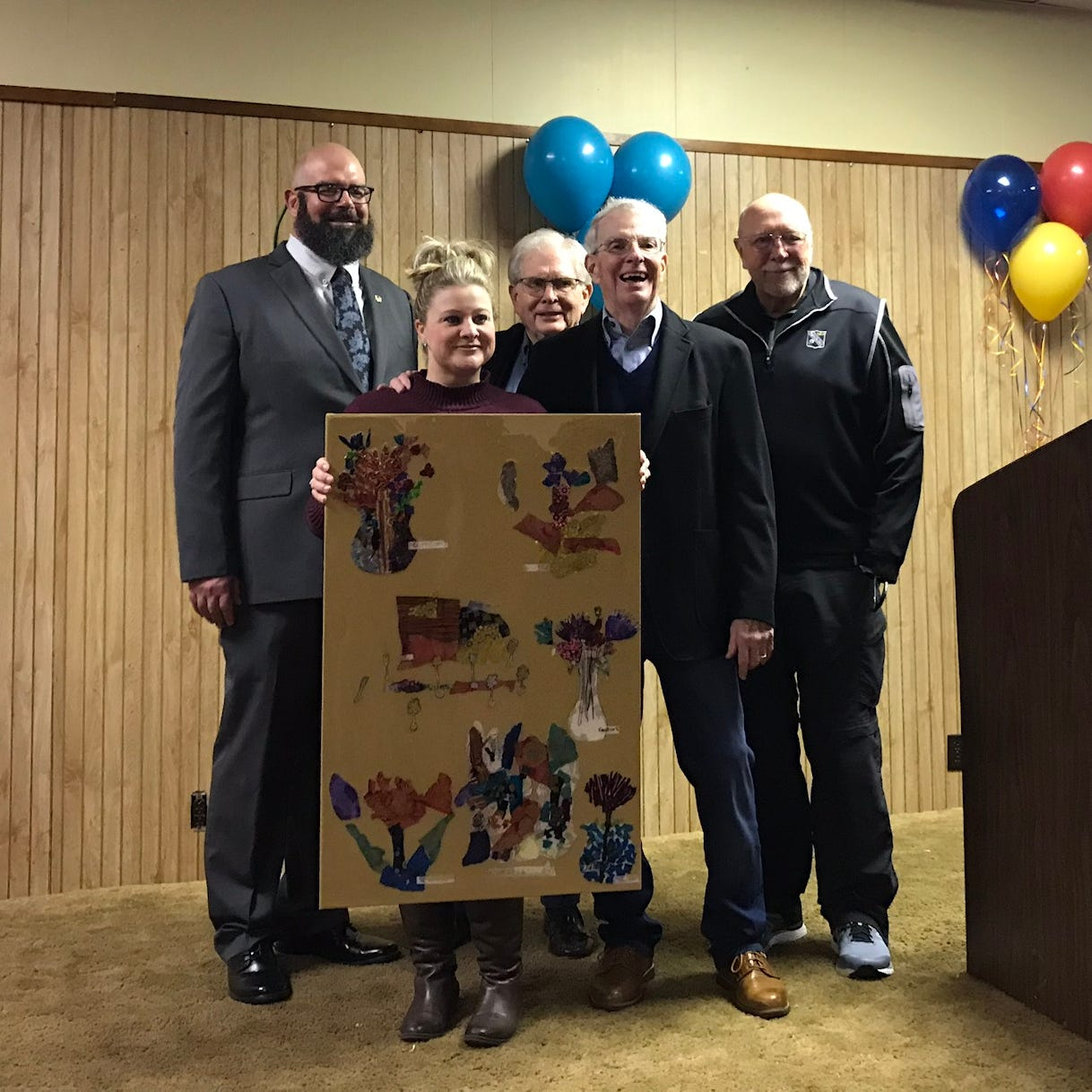Rick Robertson, Ashley White, Bill Brodie, David Turrentine and Hershel Ryan hold a piece of art created for the Jaycees in appreciation.