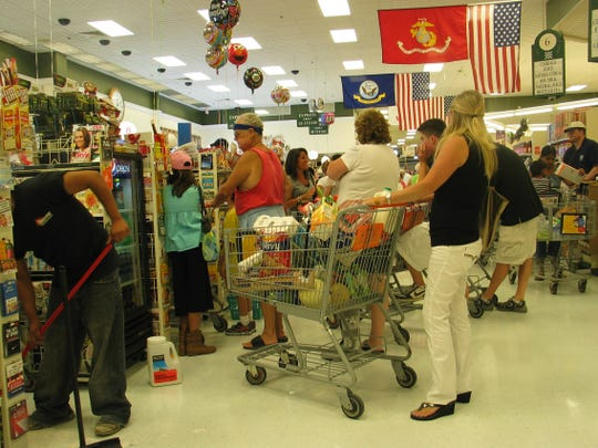 Shoppers line up Friday afternoon for water, cold cuts and other items at ShopRite on Route 46 in Parsippany to make it through Hurricane Irene. August 27, 2011.