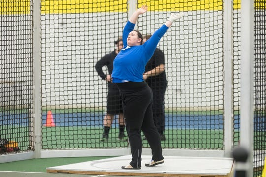 Wellesley senior Helen Andersen of Madison competes in shot put, discus and hammer.