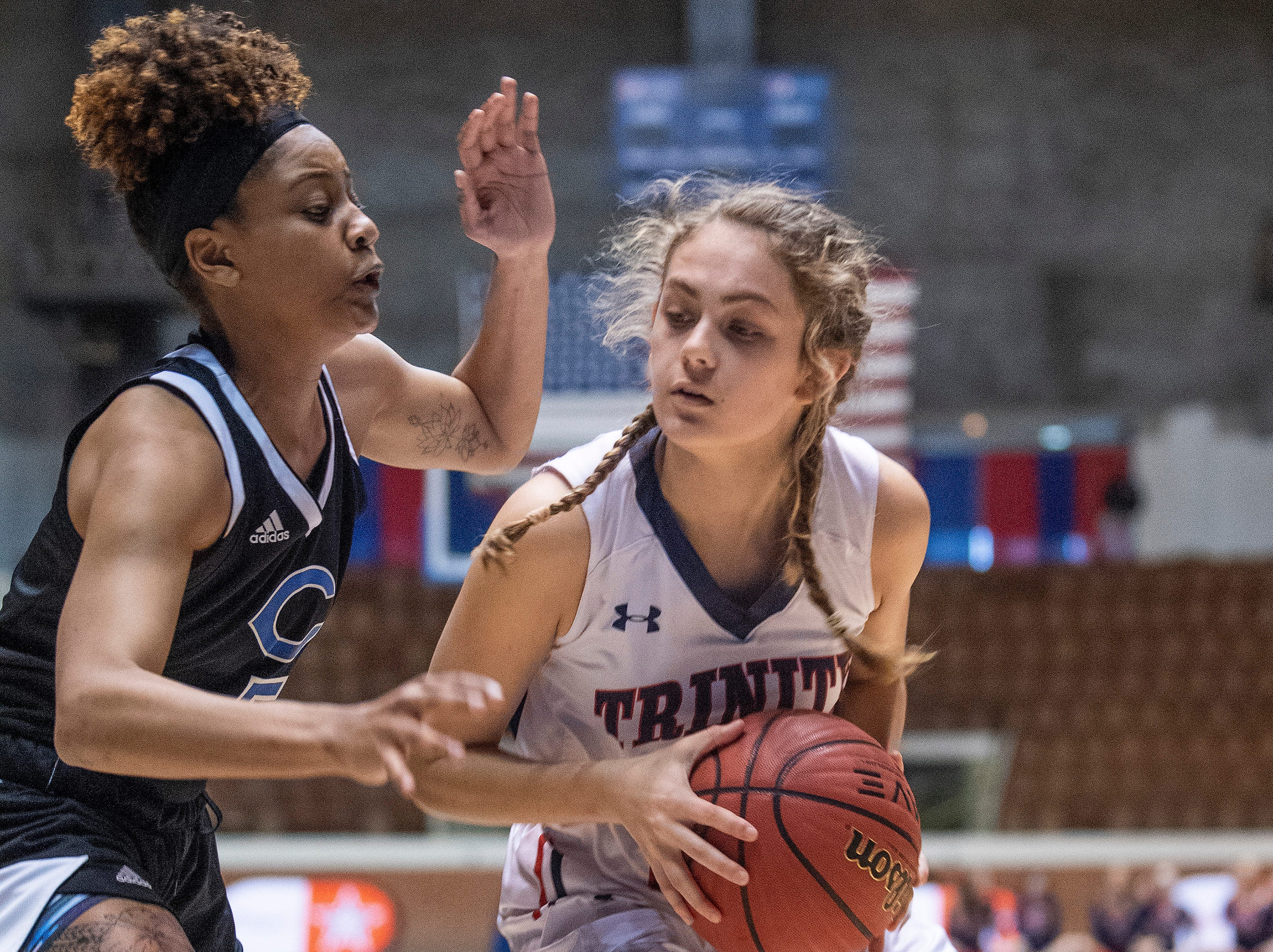 Trinity's Kaylee Peevy against Childersburg's Yamaree Gaddis in AHSAA Regional action at Garrett Coliseum in Montgomery, Ala., on Monday February 18, 2019.
