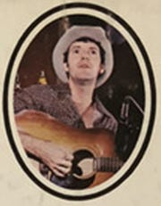 "An image of John Wilson during his early days in bluegrass music, from his band Buck Springs' album ""The Last Letter."""