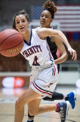 Trinity's Brooke Avant chases a loose ball against Childersburg in AHSAA Regional action at Garrett Coliseum in Montgomery, Ala., on Monday February 18, 2019.