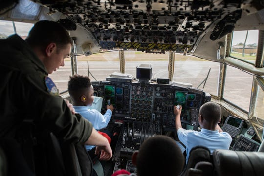 Students from Thelma S. Morris Elementary School find out what it feels like to be in the pilot's seat of a C–130 Hercules during a base visit Feb. 5, 2019, Maxwell Air Force Base, Alabama. The 42nd OSS invited T.S. Elementary School students and their teachers to demonstrate the different mission sets and careers of the Air Force, specifically careers that are STEM related.