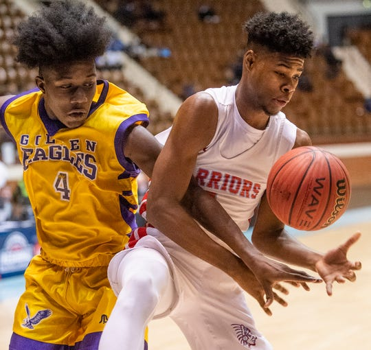 Dale County's Virgil Crawford grabs a rebound from B.T. Washington's Dakari Parker in AHSAA Regional action at Garrett Coliseum in Montgomery, Ala., on Monday February 18, 2019.