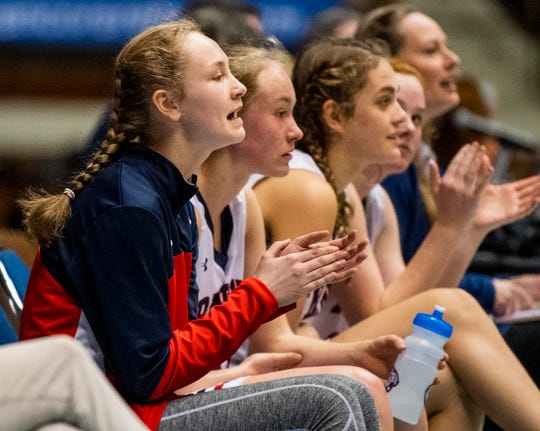 Trinity's Maddie Smith, left, cheers on the team as she sits next to her sister Emma Kate Smith late in the loss to Childersburg in AHSAA Regional action at Garrett Coliseum in Montgomery, Ala., on Monday February 18, 2019.