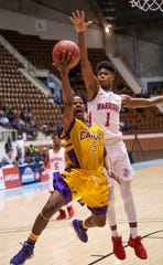 B.T. Washington's Jaquavius Harris goes to the hoop against Dale County's Virgil Crawford in AHSAA Regional action at Garrett Coliseum in Montgomery, Ala., on Monday February 18, 2019.