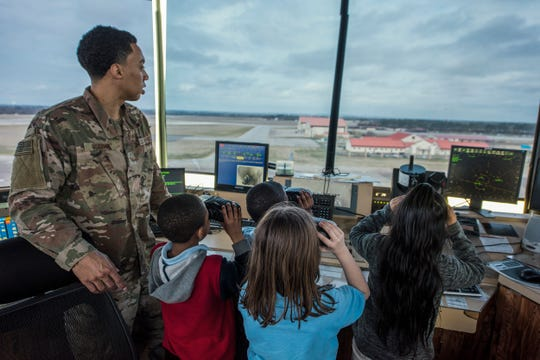 Senior Airman Anthony Morris, 42nd Operational Support Squadron air traffic controller, demonstrates the job of an air traffic controller to a group of third graders from Thelma S. Morris Elementary School Feb. 5, 2019, Maxwell Air Force Base, Alabama. The 42nd OSS invited T.S. Elementary School students and their teachers and gave them the ins and outs of air operations at Maxwell and a tour of the air traffic control tower and a C–130 Hercules.