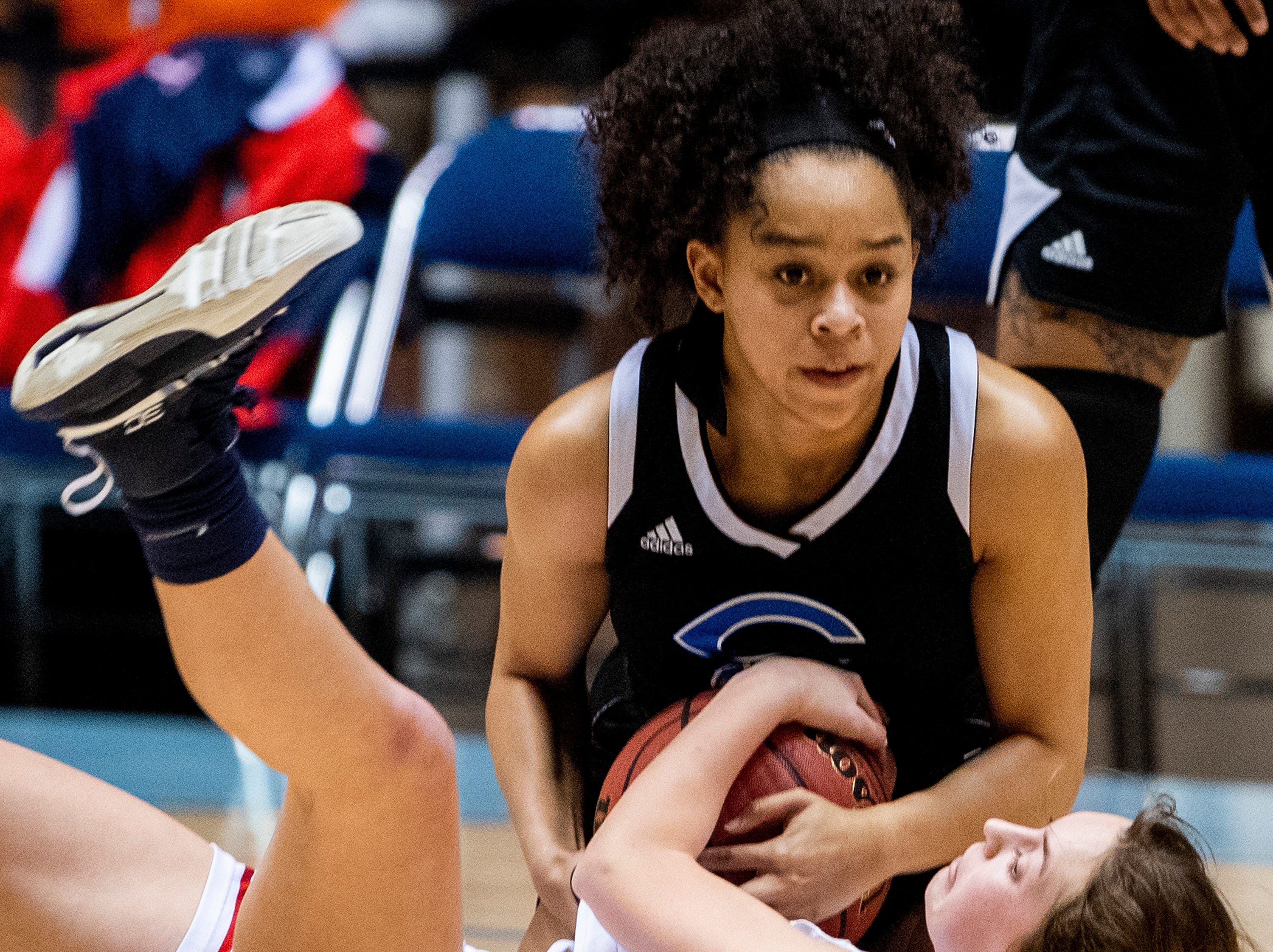 Trinity's Mary Alice Sasser and Childersburg's Jailah Swain fight for a loose ball in AHSAA Regional action at Garrett Coliseum in Montgomery, Ala., on Monday February 18, 2019.