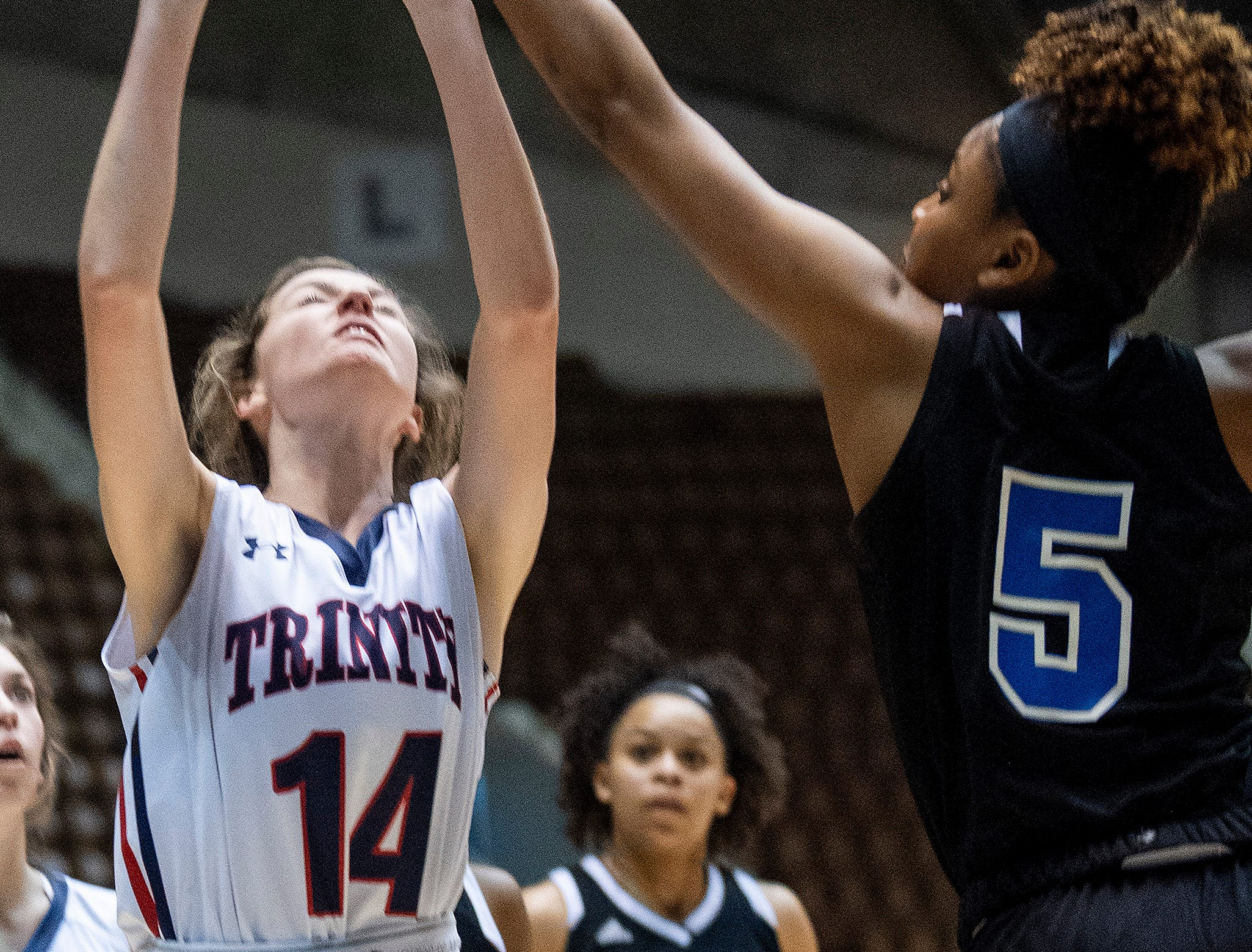 Childersburg's Yamaree Gaddis blocks the shot of Trinity's Kenslee Harrison in AHSAA Regional action at Garrett Coliseum in Montgomery, Ala., on Monday February 18, 2019.