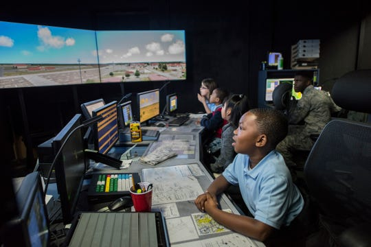 A group of third graders from Thelma S. Morris Elementary School check out the air traffic control simulator during a base visit Feb. 5, 2019, Maxwell Air Force Base, Alabama. The simulator is used to train new air traffic controllers and afterwards the students had an opportunity to climb to the top of the air traffic control tower themselves.