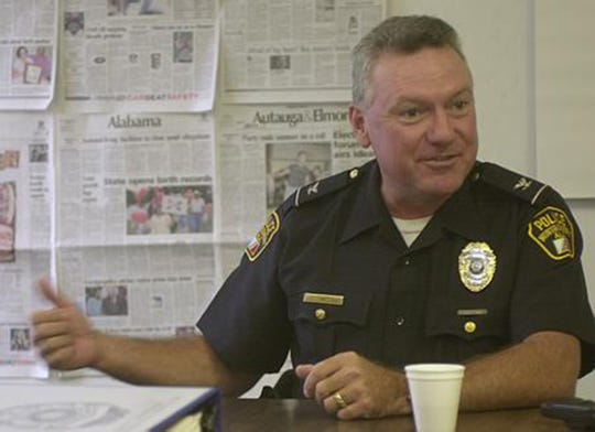 Montgomery Police Chief John Wilson talk to employees of the Montgomery Advertiser in 2000.