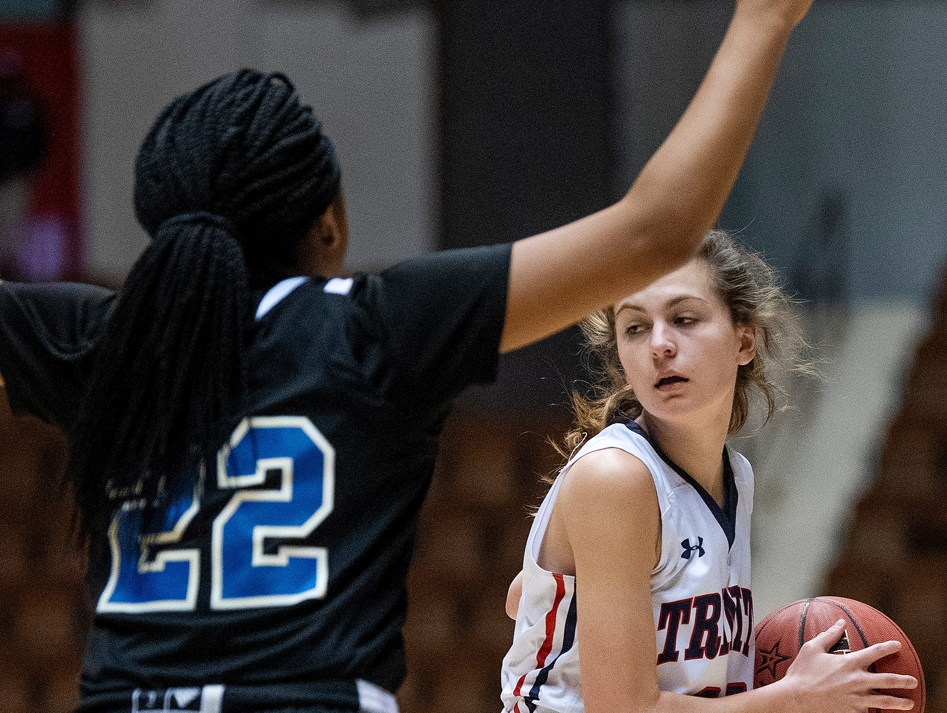 Trinity's Kenslee Harrison looks to pass against Childersburg's Keasia McKinney in AHSAA Regional action at Garrett Coliseum in Montgomery, Ala., on Monday February 18, 2019.