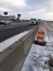 A semi tractor trailer drives on newly laid pavement on Interstate 69 near Anderson.