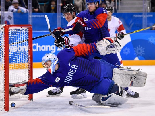 Tennessean photographer Andrew Nelles won second place in the Olympic Action category of the Pictures of the Year International competition with this photo of Korean goaltender Matt Dalton at the Pyeongchang 2018 Olympic Winter Games.