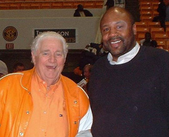 Legendary Tennessee coach Ray Mears, left, with his former player Mike Jackson, who will be honored as an SEC Legend at the SEC Tournament at Bridgestone Arena in March.