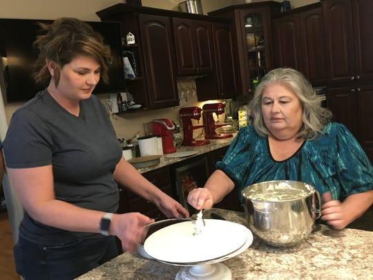 Courtney Luckett and her mom, Donna Henderson, work together in Luckett's kitchen in Orlinda.