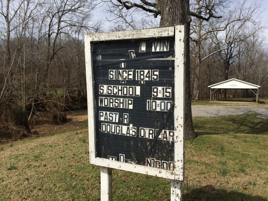 The exterior sign for the 173-year-old Eno Road United Methodist Church in Dickson after the Feb. 6 flood event.