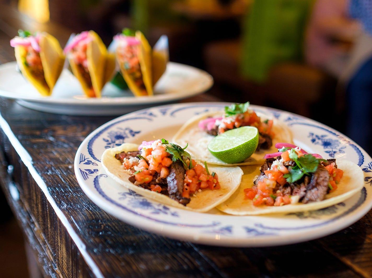 The Tradicional tacos at Rocco's Tacos & Tequila Bar feature carnitas-style pork, cilantro, onion and salsa brava.
