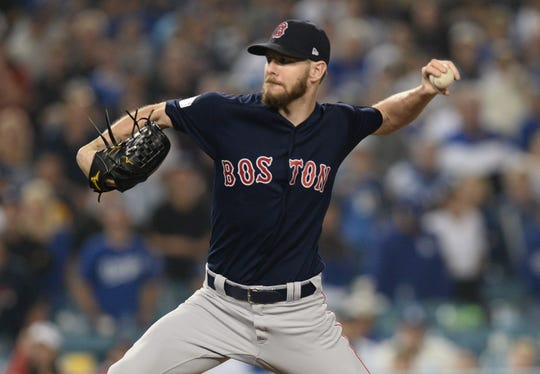 Oct 28, 2018; Los Angeles, CA, USA; Boston Red Sox pitcher Chris Sale (41) pitches in the ninth inning against the Los Angeles Dodgers in game five of the 2018 World Series at Dodger Stadium. Mandatory Credit: Gary A. Vasquez-USA TODAY Sports