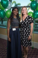Through volunteer programs tailored to foster student success, a community interest in education can help children thrive (pictured: Denise Murphy and her mentee).