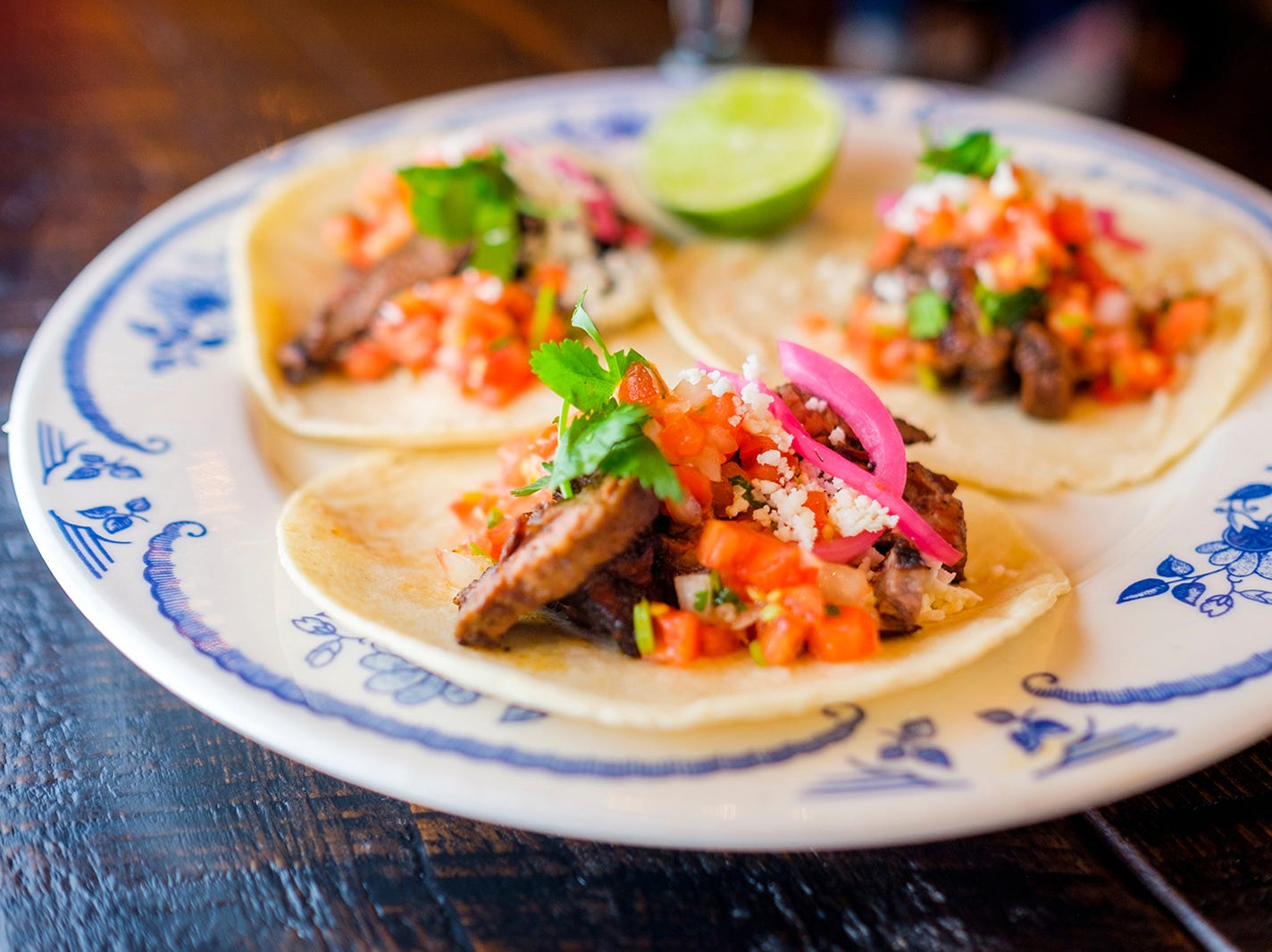 Carne asada tacos at Rocco's Tacos & Tequila Bar feature grilled marinated steak, pico de gallo, pickled red onions, cotija cheese and cilantro.