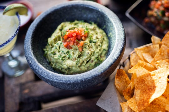 Guacamole is made tableside at Rocco's Tacos & Tequila Bar.