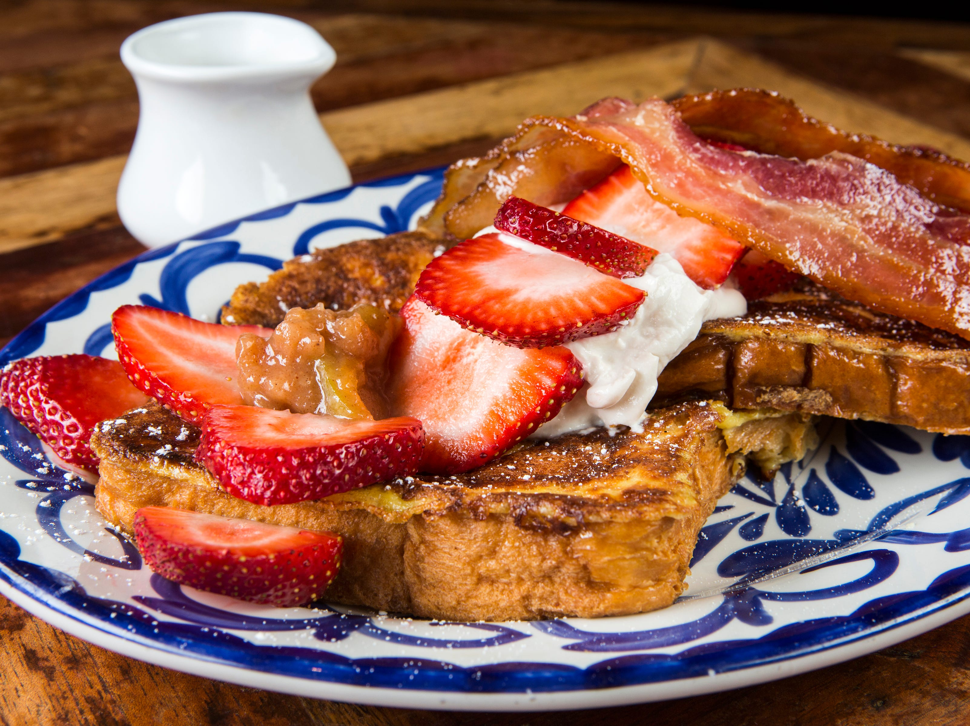 Pan Dulce y Compota Manzana at Rocco's Tacos & Tequila Bar is a brunch entree of Mexican-style French toast with bacon, agave, maple syrup, apple compote and sweet sour cream.