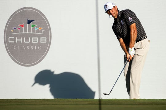 Relief Goosen chips on the 18th hole during in the final round of the Chubb Classic at The Classics at Lely Resort on Sunday.