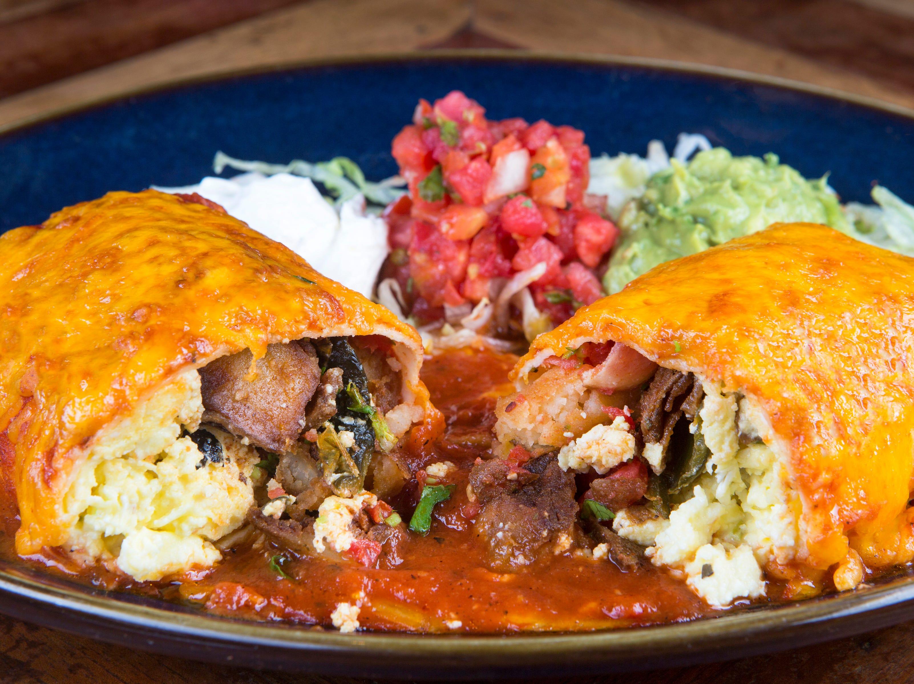 A Wet Burrito Con Huevos at Rocco's Tacos & Tequila Bar is a brunch entree with scrambled eggs, sliced poblano pepper, bacon, potatoes, cheese, guacamole, pico de gallo, sour cream and salsa roja.