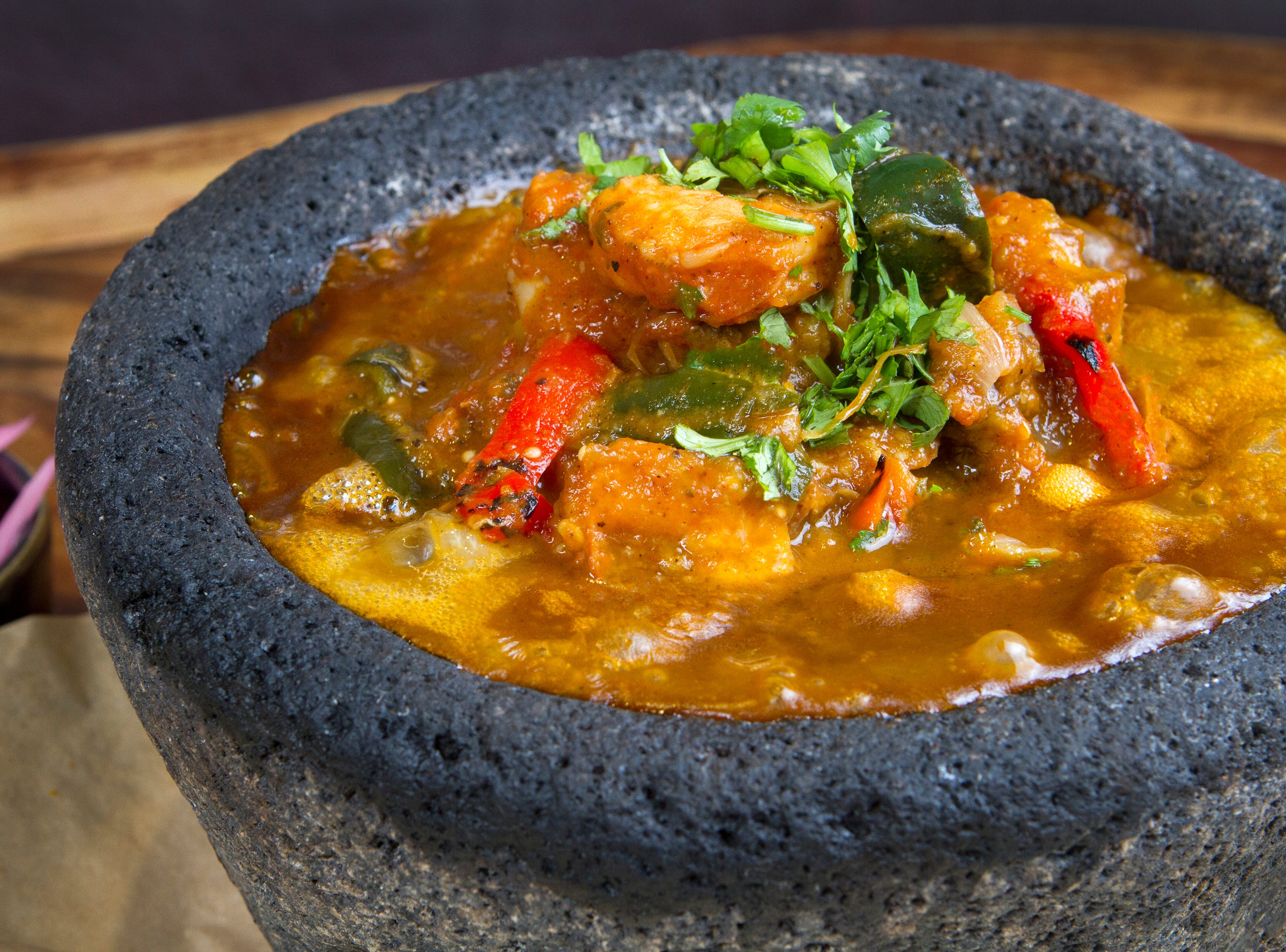 Molcajetes at Rocco's Tacos & Tequila Bar are served sizzling in a traditional lava rock molcajete.