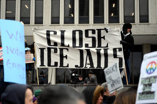 "A sign reading ""close ICE jails"" is seen during a protest on Monday, Feb. 18, 2019, in Newark. Towns across New Jersey held protests in response to President Donald Trump's national emergency declaration that would allow him to use military funds to build a wall at the southern border."