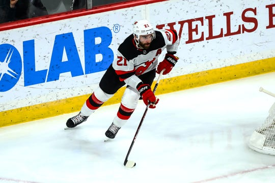 Feb 15, 2019; Saint Paul, MN, USA; New Jersey Devils right wing Kyle Palmieri (21) skates with the puck in the third period against the Minnesota Wild at Xcel Energy Center. The Devils defeated the Wild 5-4 in overtime.