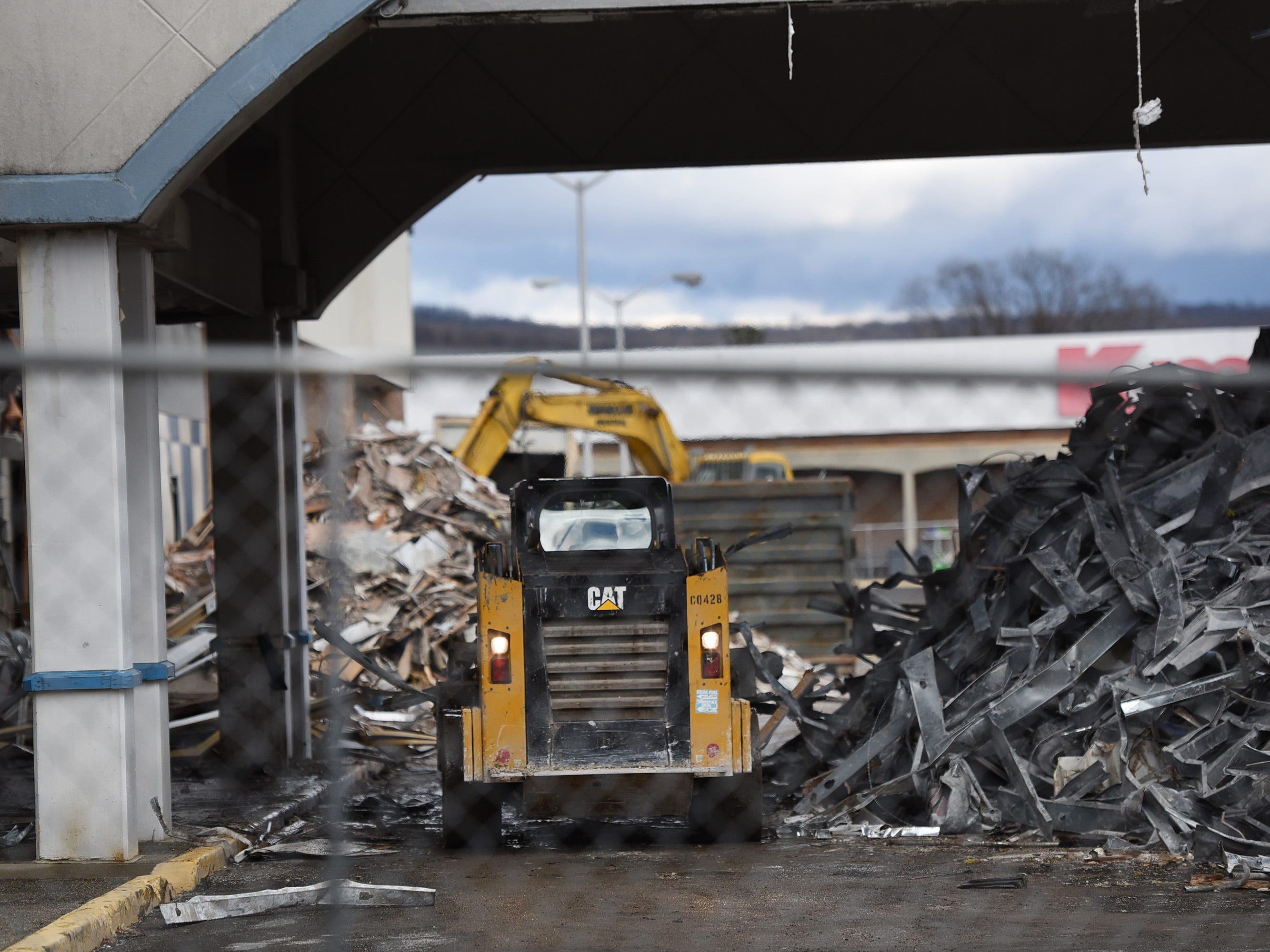 A worker operates an excavation machine as Wayne Hills Mall is being demolished, photographed   in Wayne on 02/18/19.