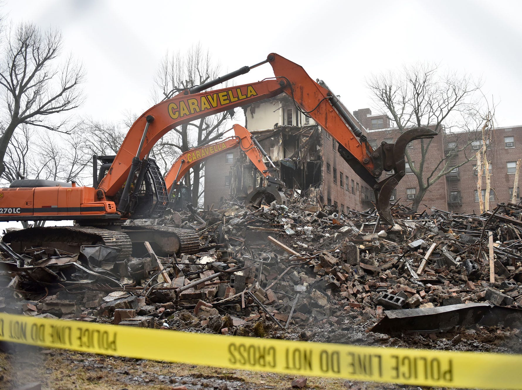 Demolition equipment is tearing down part of the apartment complex that was heavily damaged by the fire that broke out on Edwin Ave in Fort Lee on February 14, 2019.