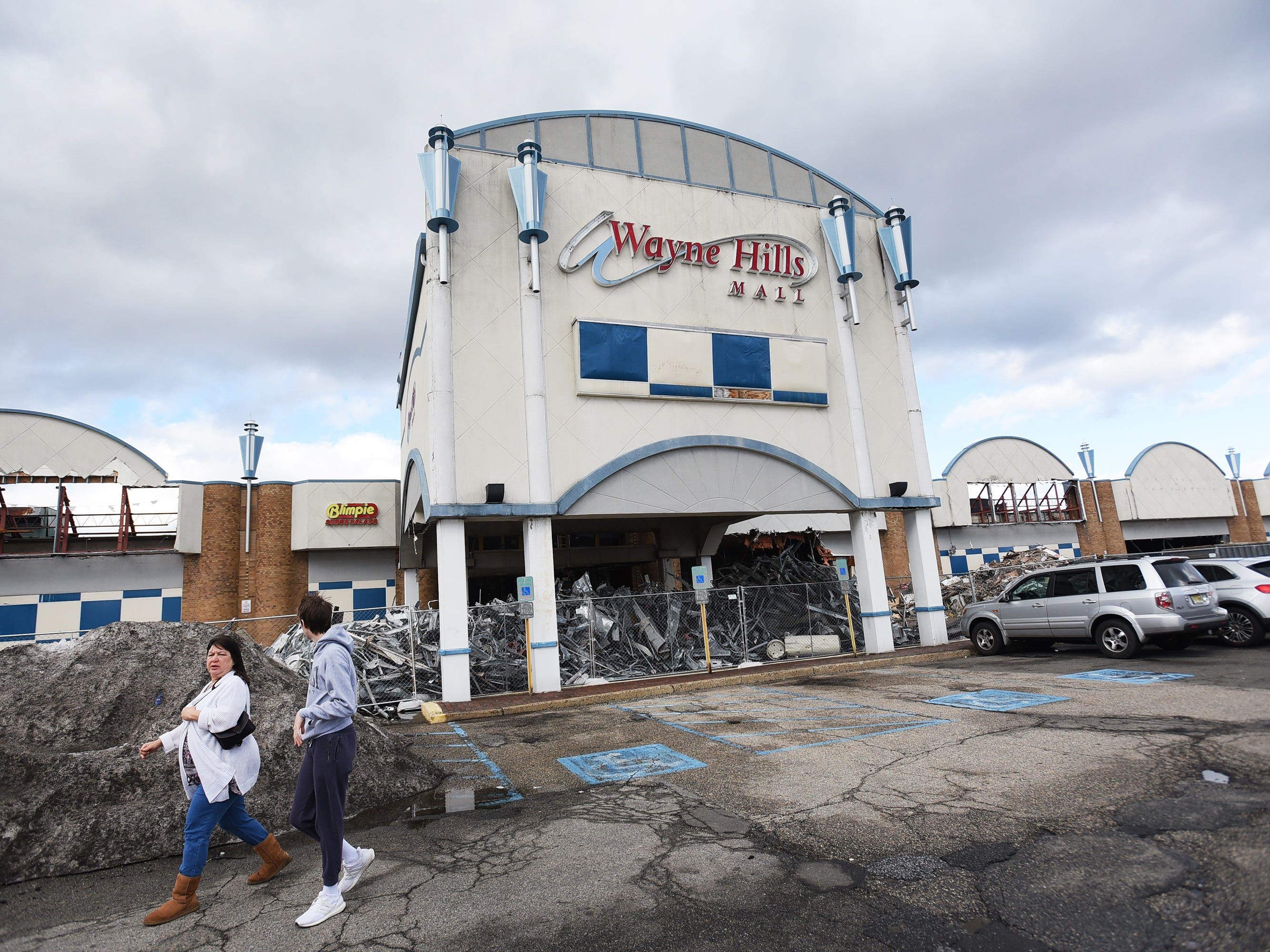 Shoppers pass by as Wayne Hills Mall is being demolished, photographed   in Wayne on 02/18/19.