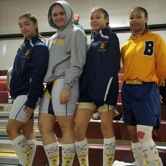 Belleville wrestlers (from left) Krystal Araujo, Jeymarie Reyes, Soraya Safforld and Alisa Safforld participated in the historic first NJSIAA region championships for female wrestlers at Red Bank Regional High on Feb. 17.